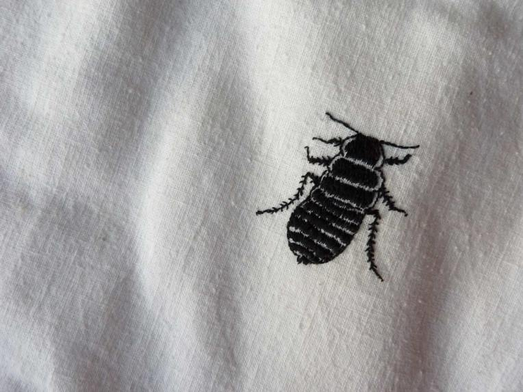 cockroach on tablecloth embroidery on cotton Belinda Broughton